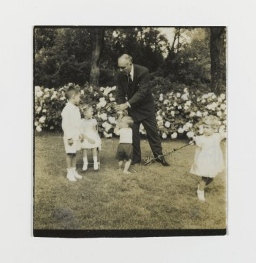 Consuelo Kanaga (American, 1894-1978). [Untitled] (Man with Four Children). Gelatin silver photograph, 2 1/4 x 2 1/4 in. (5.7 x 5.7 cm). Brooklyn Museum, Gift of Wallace B. Putnam from the Estate of Consuelo Kanaga, 82.65.150