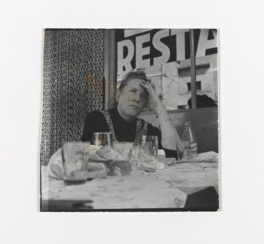 Consuelo Kanaga (American, 1894-1978). [Untitled] (Woman Seated at Restuarant). Gelatin silver photograph, 2 1/4 x 2 1/4 in. (5.7 x 5.7 cm). Brooklyn Museum, Gift of Wallace B. Putnam from the Estate of Consuelo Kanaga, 82.65.189