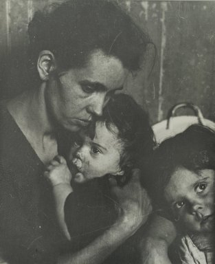 Consuelo Kanaga (American, 1894-1978). [Untitled] (Woman with Two Children). Gelatin silver photograph, 9 1/4 x 7 5/8 in. (23.5 x 19.4 cm). Brooklyn Museum, Gift of Wallace B. Putnam from the Estate of Consuelo Kanaga, 82.65.311