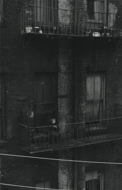 Consuelo Kanaga (American, 1894-1978). [Untitled] (Tenement, Child on Fire Escape). Gelatin silver photograph, 9 1/2 x 6 1/8 in. (24.1 x 15.6 cm). Brooklyn Museum, Gift of Wallace B. Putnam from the Estate of Consuelo Kanaga, 82.65.314