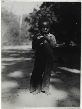 Consuelo Kanaga (American, 1894-1978). [Untitled] (Boy with Gun), 1948-1950. Gelatin silver photograph, 3 15/16 x 2 7/8 in. (10 x 7.3 cm). Brooklyn Museum, Gift of Wallace B. Putnam from the Estate of Consuelo Kanaga, 82.65.34