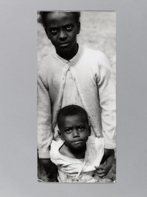 Consuelo Kanaga (American, 1894-1978). [Untitled] (Two Children in Tennessee), late 1940s. Gelatin silver photograph, 13 1/4 x 6 1/4 in. (33.7 x 15.9 cm). Brooklyn Museum, Gift of Wallace B. Putnam from the Estate of Consuelo Kanaga, 82.65.393