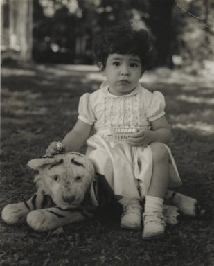 Consuelo Kanaga (American, 1894-1978). [Untitled] (Child Sitting on Stuffed Tiger). Gelatin silver photograph, 4 3/4 x 3 7/8 in. (12.1 x 9.8 cm). Brooklyn Museum, Gift of Wallace B. Putnam from the Estate of Consuelo Kanaga, 82.65.60