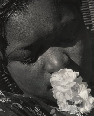 Consuelo Kanaga (American, 1894-1978). [Untitled] (Portrait with Flower), early 1930s. Gelatin silver photograph, 9 7/8 x 8 in. (25.1 x 20.3 cm). Brooklyn Museum, Gift of Wallace B. Putnam from the Estate of Consuelo Kanaga, 82.65.90