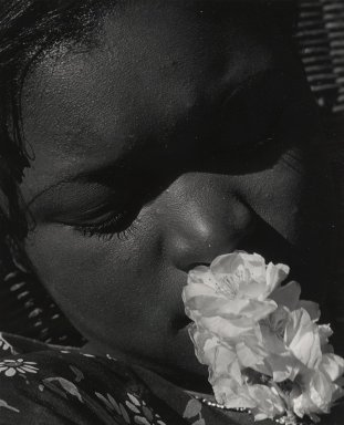 Consuelo Kanaga (American, 1894-1978). [Untitled] (Portrait with Flower), early 1930s. Toned gelatin silver photograph, 9 7/8 x 8 in. (25.1 x 20.3 cm). Brooklyn Museum, Gift of Wallace B. Putnam from the Estate of Consuelo Kanaga, 82.65.91