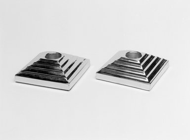 """Norman Bel Geddes (American, 1893-1958). """"Manhattan"""" Candlestick, One of a Pair, 1937. Chromed metal, 1 1/16 x 3/1/8 x 3 1/8 in. (2/7 x 8.0 x 8.0 cm). Brooklyn Museum, Gift of Paul F. Walter, 83.108.15. Creative Commons-BY"""