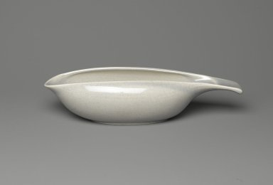 Russel Wright (American, 1904-1976). Gravy Boat, Part of Two-Piece Set, American Modern Pattern, Designed 1937; manufactured 1939-1959. Glazed ceramic, 2 1/2 x 2 1/2 x 10 3/8 in. (6.4 x 6.4 x 26.2 cm). Brooklyn Museum, Gift of Paul F. Walter, 83.108.32. Creative Commons-BY