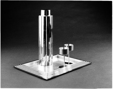 "Norman Bel Geddes (American, 1893-1958). ""Skyscraper"" Cocktail Shaker with Strainer and Lid, Designed 1934. Manufactured 1935. Chrome-plated metal, 12 3/4 x 3 5/16 x 3 5/16 in. (32.4 x 8.4 x 8.4 cm). Brooklyn Museum, Gift of Paul F. Walter, 83.108.5a-c. Creative Commons-BY"