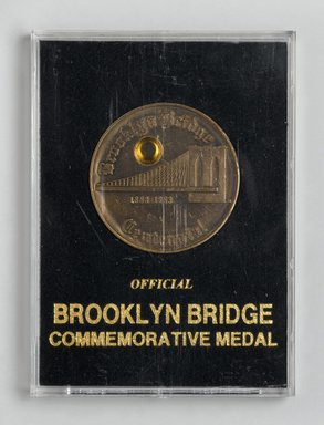 Brooklyn Bridge Centennial Medal, 1983. Metal, cloth, cardboard, plexiglass, Case: 3 3/4 x 2 3/4 in. (9.5 x 7 cm). Brooklyn Museum, Ella C. Woodward Memorial Fund, 83.126.4. Creative Commons-BY