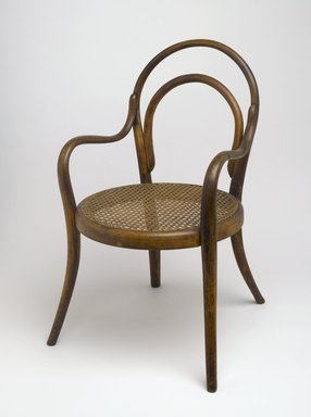 Gebrüder Thonet. Child's Armchair, ca. 1875. Copper beech, modern caning, 24 3/4 x 14 x 17 1/4 in. (62.9 x 35.6 x 43.8 cm). Brooklyn Museum, Gift of Dr. Barry R. Harwood, 83.155. Creative Commons-BY