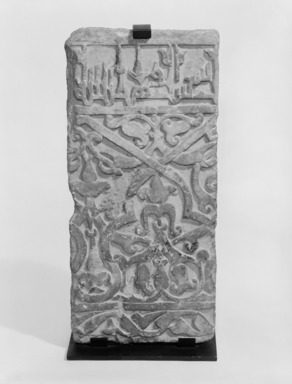Dado Panel from the Courtyard of the Royal Palace of Mas`ud III of Ghazni (reigned A.H. 493-509/ 1009-1115 C.E., 1 Ramadan 505 AH / 22 March 1112. Carved marble, 2009 dimensions: 28 1/8 x 12 13/16 x 3 1/2 in. (71.4 x 32.5 x 8.9 cm). Brooklyn Museum, Gift of Mr. and Mrs. Hans G. Clapper, 83.163. Creative Commons-BY