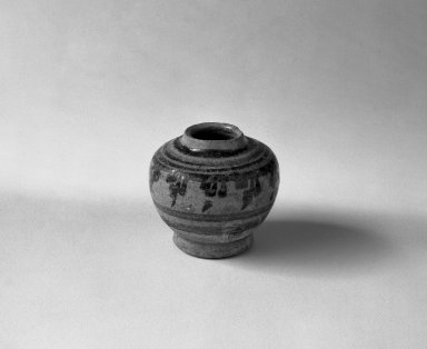 Sawankhalok Miniature Jar, 2 of 5, 14th century. Buff stoneware, H: 1 5/8 in. (4.1 cm). Brooklyn Museum, Gift of Dr. Joel Canter, 83.181.4. Creative Commons-BY