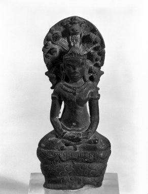 Buddha Sheltered by Mucalinda, 12th-13th century. Bronze, 4 1/2 x 1 7/8 in. (11.4 x 4.8 cm). Brooklyn Museum, Gift of Dr. Malcolm Idelson, 83.237.4. Creative Commons-BY