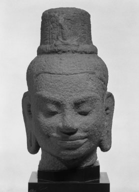 Head of a Bodhisattva Lokesvara, Bayon style, late 12th-early 13th century. Sandstone, 8 7/8 in. (22.5 cm). Brooklyn Museum, Gift of Carol L. Brewster, 83.253. Creative Commons-BY