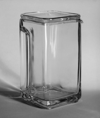 Wilhelm Wagenfeld (1900-1990). Tall Pitcher with Lid, from 10-Piece Set of Kitchen Storage Glassware, Kubus, ca. 1938. Clear glass, overall height: 6 1/2 in. (16.5 cm). Brooklyn Museum, Gift of Barry Friedman, 84.121.1a-b. Creative Commons-BY