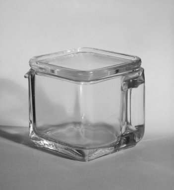Wilhelm Wagenfeld (1900-1990). Short Pitcher with Lid, from 10-Piece Set of Kitchen Storage Glassware, Kubus, ca. 1942. Clear glass, overall height: 3 1/2 in. (9.0 cm). Brooklyn Museum, Gift of Barry Friedman, 84.121.3a-b. Creative Commons-BY