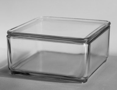 Wilhelm Wagenfeld (1900-1990). Rectangular Container with Lid, from 10-Piece Set of Kitchen Storage Glassware, Kubus, ca. 1938. Clear glass, overall height: 3 5/8 in. (9.2 cm). Brooklyn Museum, Gift of Barry Friedman, 84.121.4a-b. Creative Commons-BY