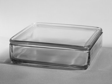 Wilhelm Wagenfeld (1900-1990). Square Container with Lid, from 10-Piece Set of Kitchen Storage Glassware, Kubus, ca. 1938. Clear glass, overall height: 2 1/8 in. (5.5 cm). Brooklyn Museum, Gift of Barry Friedman, 84.121.5a-b. Creative Commons-BY