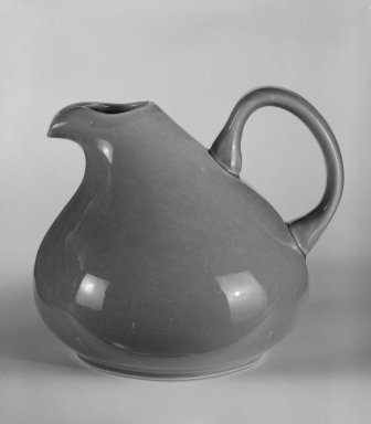 "Russel Wright (American, 1904-1976). Pitcher ""American Modern"" Pattern, ca. 1937. Earthenware with coral glaze, 6 3/8 x 6 1/4 x 7 1/2 in. (16.2 x 15.9 x 19.1 cm). Brooklyn Museum, Gift of Paul F. Walter, 84.124.3. Creative Commons-BY"
