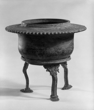 Holy Water Bowl and Stand, 13th-15th century. Bronze, 6 1/4 x 6 5/8 in. (15.9 x 16.8 cm). Brooklyn Museum, Gift of Dr. Andrew Dahl, 84.133.2a-b. Creative Commons-BY