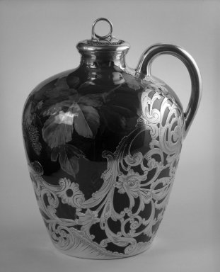 Rookwood Pottery Company (1880-1967). Whiskey Jug with Lid, ca. 1891. Glazed white clay with silver overly, 8 x 6 1/2 x 6 in. (20.3 x 16.5 x 15.2 cm). Brooklyn Museum, Gift of Mr. and Mrs. Jay Lewis, 84.176.5a-b. Creative Commons-BY