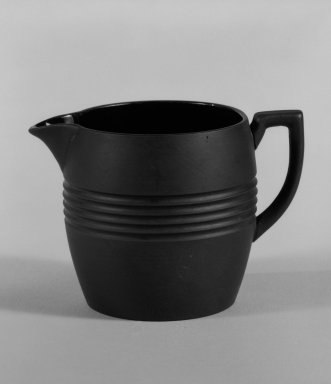 Keith Murray (English, born New Zealand, 1892-1981). Creamer, 1931-1938. Basalt ware, 2 3/4 x 3 3/4 x 2 1/2 in. (7 x 9.5 x 6.4 cm). Brooklyn Museum, Gift of Paul F. Walter, 84.178.2. Creative Commons-BY