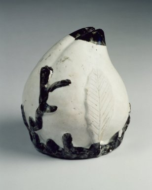 Water Dropper in the Shape of a Peach, 19th century. White Porcelain with iron oxide brown-black pigment under a clear glaze, 5 1/8 in. (13 cm). Brooklyn Museum, Gift of Dr. and Mrs. John P. Lyden, 84.196.5. Creative Commons-BY