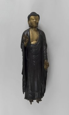 Amida Nyorai (Amitabha Buddha), 19th century or earlier. Gilt and lacquered wood, 30 1/2 x 9 1/4 in. (77.5 x 23.5 cm). Brooklyn Museum, Gift of Edna Severin, 84.204. Creative Commons-BY
