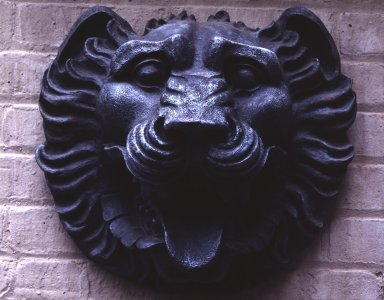 William Welles Bosworth (American, 1868-1966). Lion's Head Ornament, from A.T. & T. Building, 195 Broadway, NYC, ca. 1913. Bronze, 14 x 15 x 9 in. (35.6 x 38.1 x 22.9 cm). Brooklyn Museum, Gift of Stanley Smith, President, A.T. & T. Resource Management, 84.215. Creative Commons-BY