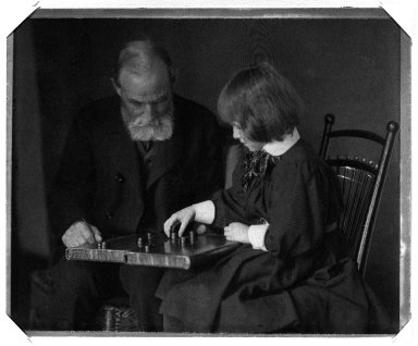 Gertrude Kasebier (American, 1852-1934). [Untitled] (Seated Portrait of William Rand and Grandaughter Peggy Lee Playing Checkers), ca. 1898-1900. Platinum print, image: 4 15/16 x 6 1/8 in. (12.5 x 15.5 cm). Brooklyn Museum, Gift of Mr. and Mrs. Miguel LaSalle and Peter Sinclair, 84.22.3