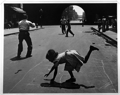 Walter Rosenblum (American, 1919-2006). Hopscotch. 105th St., New York, 1952. Gelatin silver photograph on white wove paper, sheet: 11 x 14 in.  (27.9 x 35.6 cm); image: 10 1/2 x 13 7/16 in. (26.7 x 34.1 cm). Brooklyn Museum, Gift of Lisa Rosenblum, 84.236.12. © Rosenblum Archive