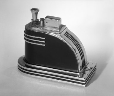 "Louis V. Aronson. Cigarette Lighter, ""Ronson Touch-Tip,"" ca. 1935. Chrome and black-enameled metal, 3 3/8 x 4 3/8 x 2 1/4 in. (8.6 x 11.1 x 5.7 cm). Brooklyn Museum, Gift of David A. Hanks, 84.276a-b. Creative Commons-BY"