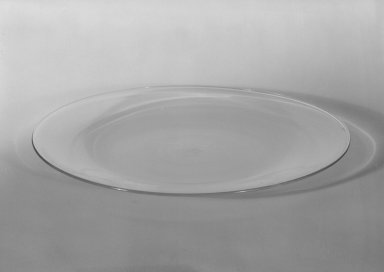 Wilhelm Wagenfeld (1900-1990). Cake Plate, 1930-1934. Clear heat-resistant glass, 9/16 x 7 7/8 in. (1.4 x 20 cm). Brooklyn Museum, Gift of Barry Friedman, 84.64.14. Creative Commons-BY