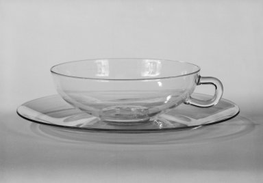 Wilhelm Wagenfeld (1900-1990). Cup and Saucer, 1930 -1934. Clear heat-resistant glass, 1 3/8 x 5 1/8 x 3 7/8 in. (3.5 x 13 x 9.8 cm). Brooklyn Museum, Gift of Barry Friedman, 84.64.4a-b. Creative Commons-BY