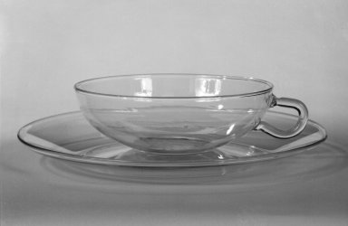 Wilhelm Wagenfeld (1900-1990). Cup and Saucer, 1930 -1934. Clear heat-resistant glass, 1 3/8 x 5 1/8 x 3 7/8 in. (3.5 x 13 x 9.8 cm). Brooklyn Museum, Gift of Barry Friedman, 84.64.6a-b. Creative Commons-BY