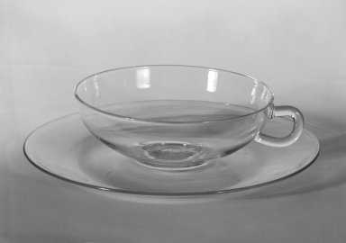 Wilhelm Wagenfeld (1900-1990). Cup and Saucer, 1930-1934. Clear heat-resistant glass, 1 3/8 x 5 1/8 x 3 7/8 in. (3.5 x 13 x 9.8 cm). Brooklyn Museum, Gift of Barry Friedman, 84.64.7a-b. Creative Commons-BY