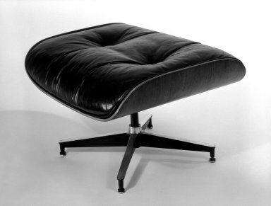 Charles Eames (American, 1907-1978). Ottoman, Model 671, Designed 1956; this example manufactured mid-1960s. Molded rosewood plywood, leather, 16 3/4 x 25 1/2 x 22 in. (42.5 x 64.8 x 55.9 cm). Brooklyn Museum, Gift of Alice Topp Lee in memory of David Conant Ford, 84.65.2. Creative Commons-BY