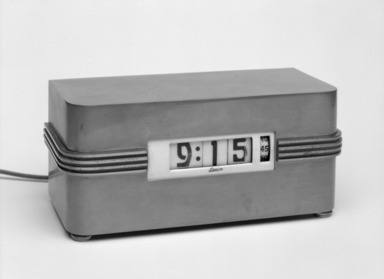 Kem Weber (American, born Germany, 1889-1963). Clock, 1948-1975. Brass, 3 3/8 x 7 11/16 x 3 1/4 in. (8.6 x 19.5 x 8.3 cm). Brooklyn Museum, Gift of Paul F. Walter, 85.109.10. Creative Commons-BY