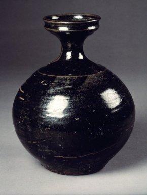 Bottle, 19th century. Stoneware with glaze, Height: 7 1/4 in. (18.4 cm). Brooklyn Museum, Gift of Mr. and Mrs. Roger Elliot and Mr. and Mrs. Jack Ford in memory of Jean Alexander, 85.114.5. Creative Commons-BY