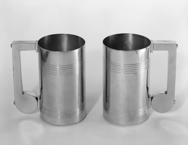 Theodore Hess (American, born Germany, 1873-ca. 1937). Mug, ca. 1937. Chrome-plated metal, 5 9/16 x 5 1/8 x 3 1/4 in. (14.1 x 13 x 8.3 cm). Brooklyn Museum, H. Randolph Lever Fund, 85.163.3. Creative Commons-BY