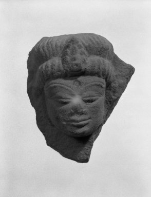 Kaushambi (Uttar Pradesh). Head of Deity, 4th-5th century. Tan sandstone, 2 5/8 x 2 5/16 in. (6.6 x 5.9 cm). Brooklyn Museum, Gift of Norvin Hein, 85.216.1. Creative Commons-BY