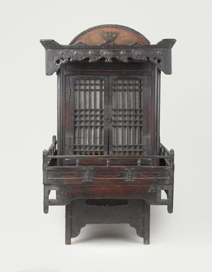 Funerary Sedan Chair, 19th century. Wood, metal, paper, 34 1/2 x 20 1/2 x 25 1/4 in.  (87.6 x 52.1 x 64.1 cm). Brooklyn Museum, Designated Purchase Fund, 85.224. Creative Commons-BY