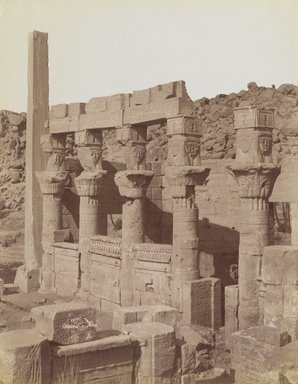 Antonio Beato (Italian and British, after 1832-1906). Philae (View from the northeast of the south end of the West Colonnade and the Porch of Nectanebo at the Temple of Isis), late 19th century. Albumen silver photograph, image/sheet: 7 3/4 x 10 1/4 in. (19.7 x 26 cm). Brooklyn Museum, Gift of Matthew Dontzin, 85.305.15