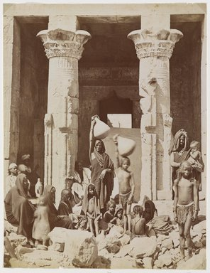 Pascal Sébah (Turkish, 1823-1886). A Group of Egyptians in Front of the Temple of Dendera (Dendur), late 19th century. Albumen silver photograph Brooklyn Museum, Gift of Matthew Dontzin, 85.305.25
