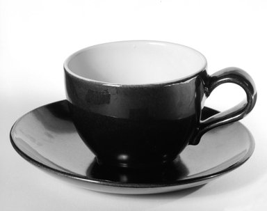 Eva Zeisel (American, born Hungary, 1906-2011). Cup and Saucer, designed ca. 1945; produced ca. 1946. Glazed earthenware, Cup: 2 5/8 x 5 1/8 x 3 3/4 in. (6.7 x 13 x 9.5 cm). Brooklyn Museum, Gift of Eva Zeisel, 85.75.16a-b. Creative Commons-BY