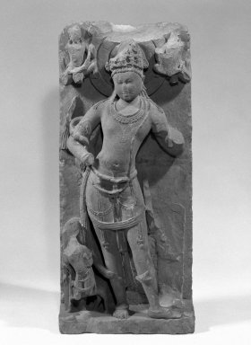 Standing Deity, probably Yama, ca. 800 C.E. Sandstone relief, 44 x 19 in. (111.8 x 48.3 cm). Brooklyn Museum, Gift of Georgia and Michael de Havenon, 86.183.3. Creative Commons-BY