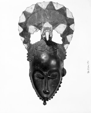 Baule. Mask with Crescent Shaped Form Above Face and Figure of an Elephant, 19th or 20th century. Wood, paint, 2 ferrous nails, 16 1/4 x 9 in. (41.3 x 22.9 cm). Brooklyn Museum, Gift of the Ernest Erickson Foundation, Inc., 86.224.151. Creative Commons-BY