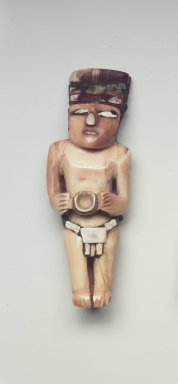 Nasca. Figurine, C.E. 300-700. Ivory, turquois, stone, resin, pigment, 2 1/2 x 1/8 x 3/4 in. (6.4 x 0.3 x 1.9 cm). Brooklyn Museum, Gift of the Ernest Erickson Foundation, Inc., 86.224.195. Creative Commons-BY