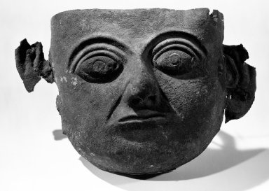 Nasca. Mask, C.E. 100 - 300. Copper, 2 9/16 in. Brooklyn Museum, Gift of the Ernest Erickson Foundation, Inc., 86.224.198. Creative Commons-BY