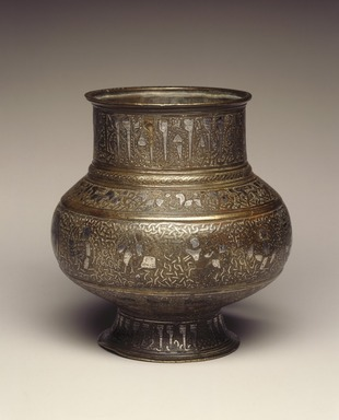 Jug (Mashraba) with Human-Headed Inscription and Zodiac Signs, late 12th-early 13th century. Copper alloy, engraved, inlaid and overlaid with silver, height: 5 1/2 in. (14 cm). Brooklyn Museum, Gift of the Ernest Erickson Foundation, Inc., 86.227.123. Creative Commons-BY